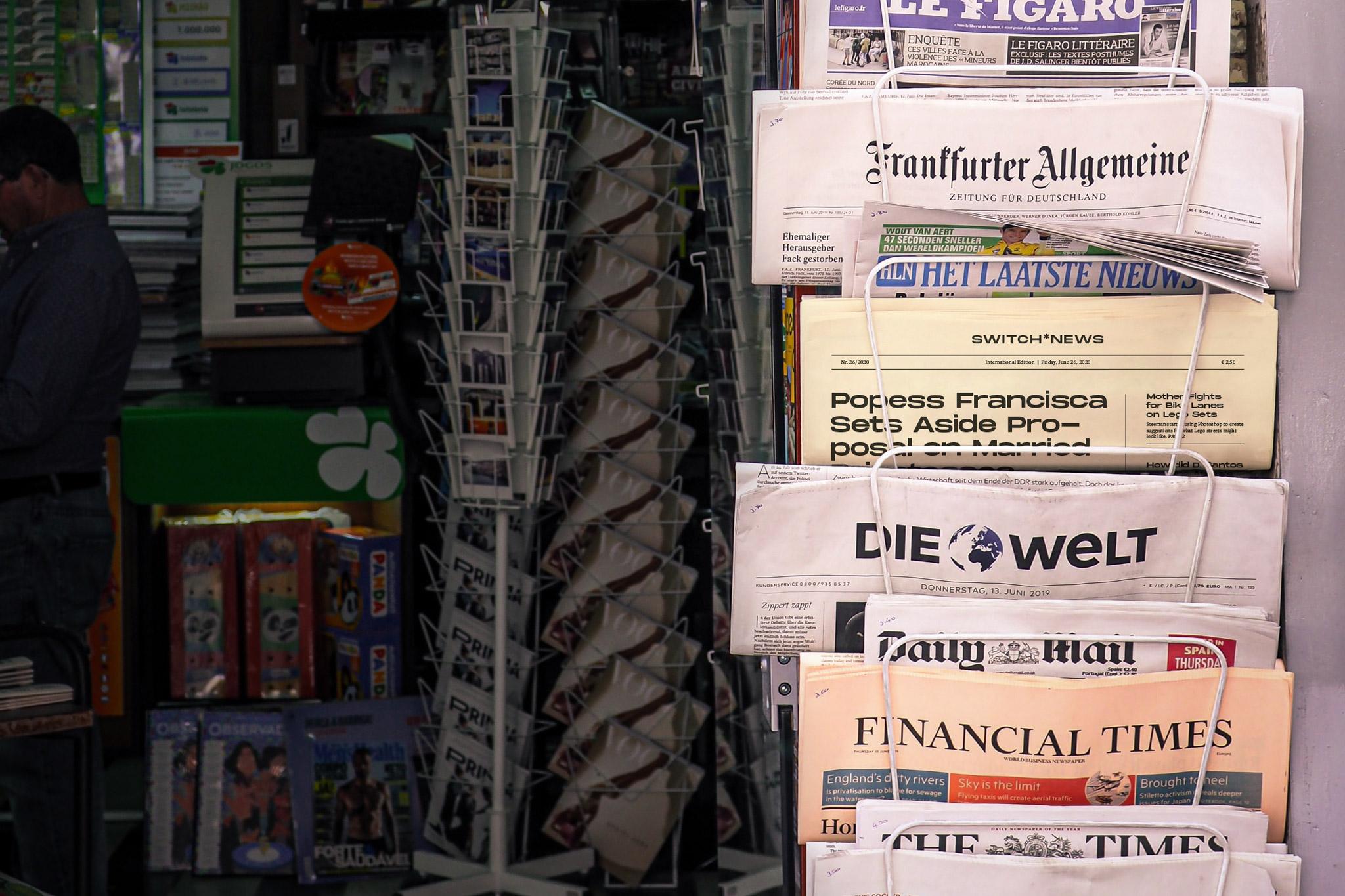 International press at display at a newsstand.