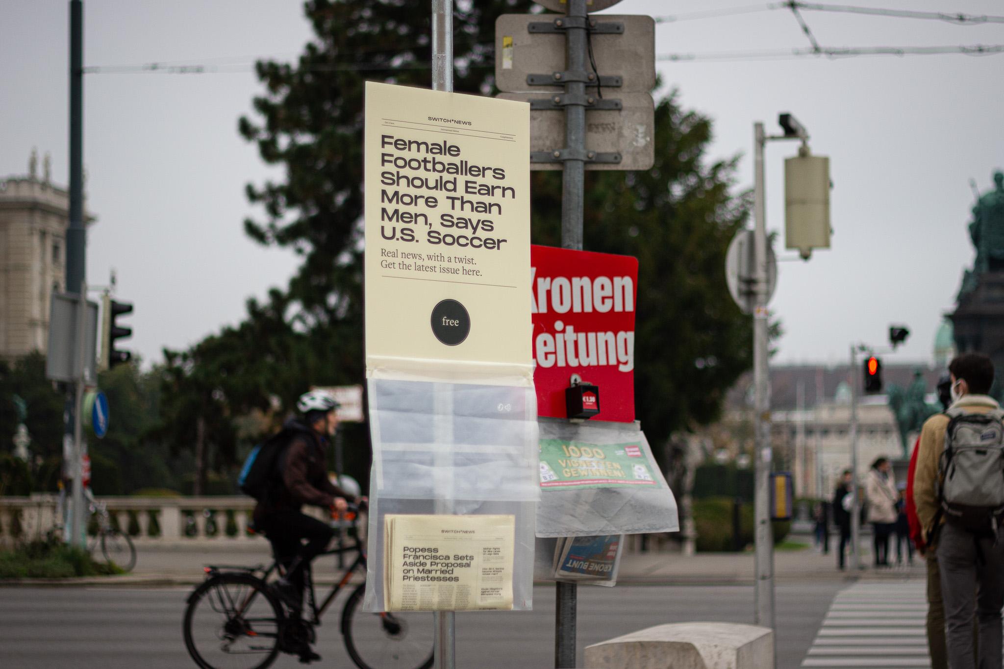 Newspaper bag on display next to Austria's biggest tabloid.