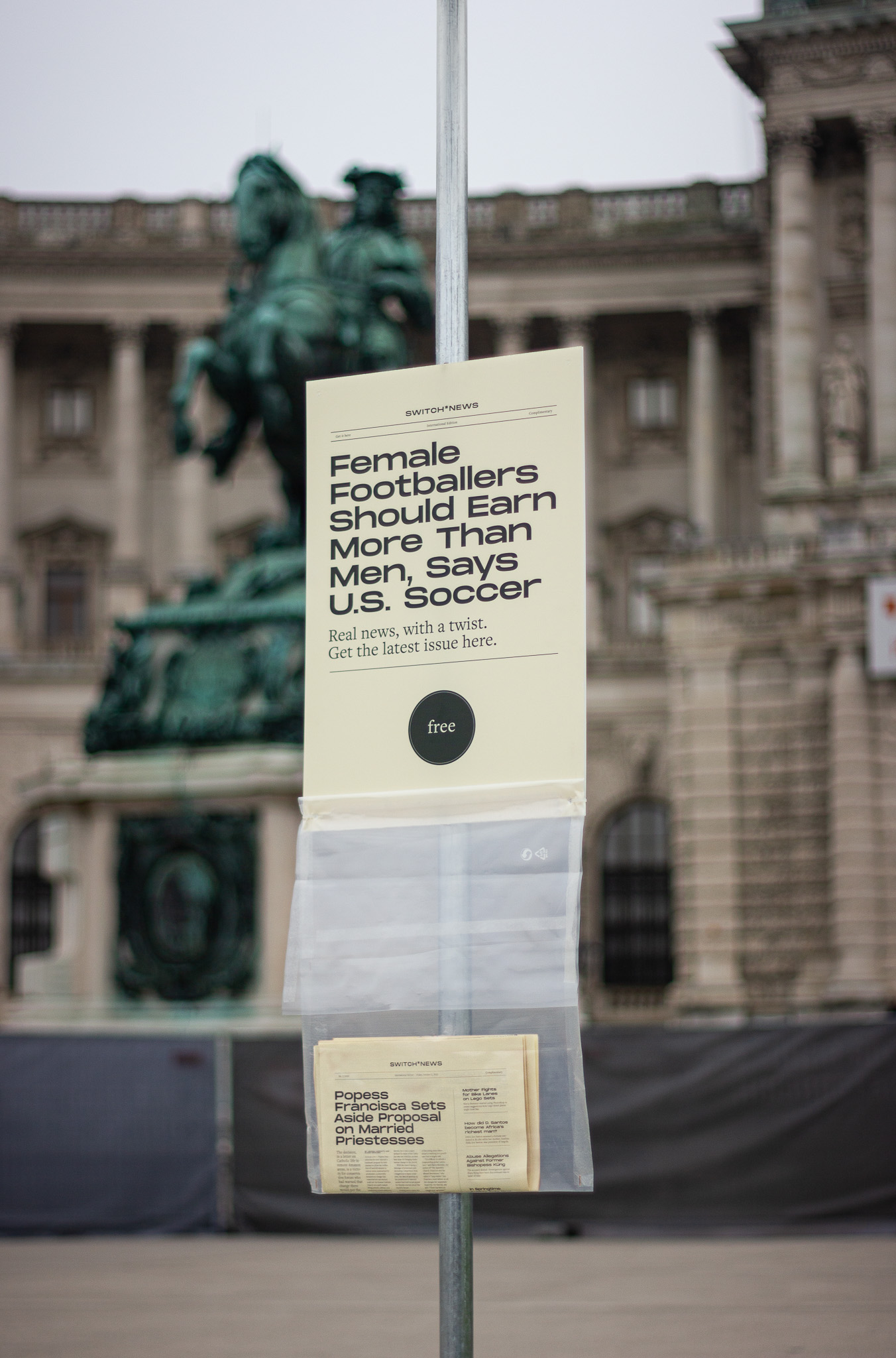 Newspaper bag on display in front of Vienna's Hofburg Palace.